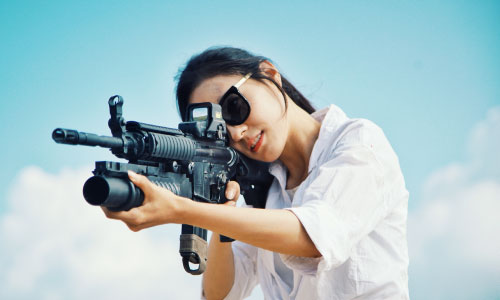 Girl aiming at a gun range
