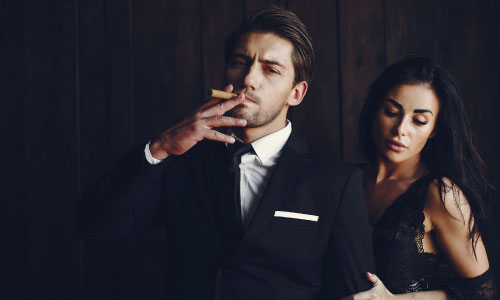 well dressed man with cigar